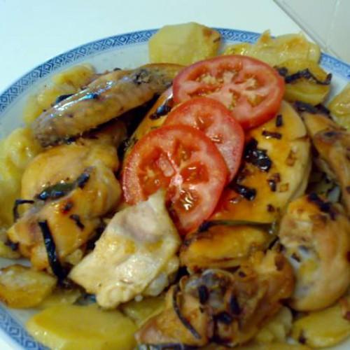 pollo entero troceado al horno con patatas