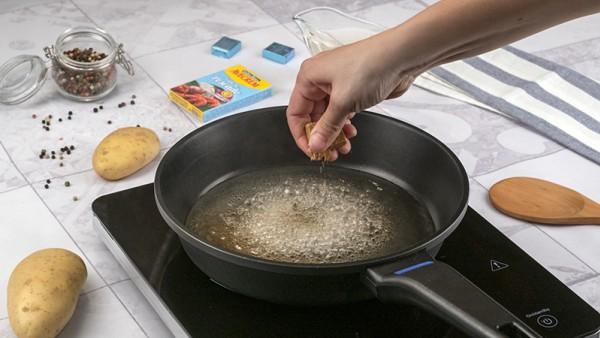 Lubina al horno con patatas Paso 1